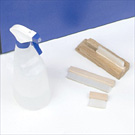 Manual brush holder and spray bottle